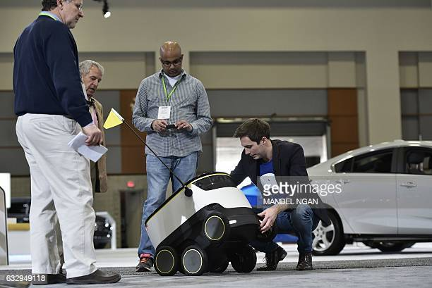 Henry HarrisBurland explains the operation of the Starship Technologies delivery robot on January 26 2017 at the Washington Auto Show in Washington...