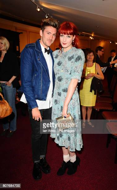 Henry Holland and Florence Welch are seen at the English National Ballets 60th Anniversary production of Swan Lake at the Royal Albert Hall in London