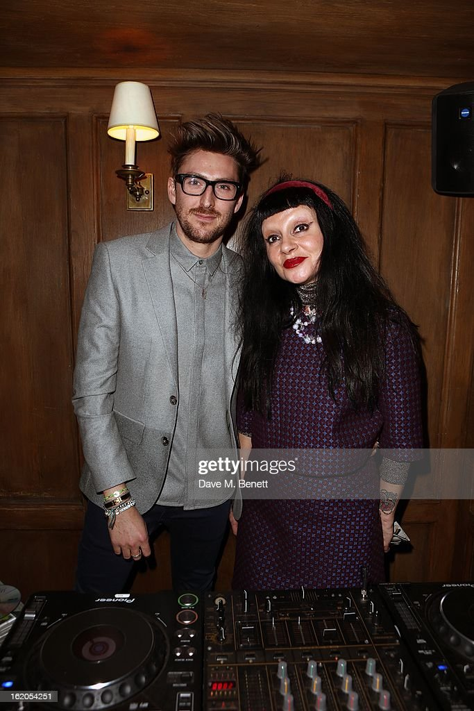 Henry Holland (L) and guest attend the Richard Nicoll and Louise Gray after party at Soho House on February 18, 2013 in London, England.