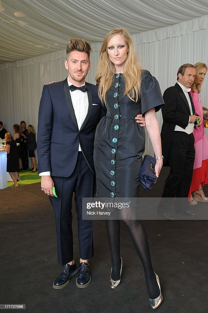 Henry Holland and Jade Parfitt attend the 15th Annual White Tie and Tiara Ball to Benefit Elton John AIDS Foundation in Association with Chopard at Woodside on June 27, 2013 in Windsor, England. No sales to online/digital media worldwide until the 14th of July. No sales before July 14th, 2013 in UK, Spain, Switzerland, Mexico, Dubai, Russia, Serbia, Bulgaria, Turkey, Argentina, Chile, Peru, Ecuador, Colombia, Venezuela, Puerto Rico, Dominican Republic, Greece, Canada, Thailand, Indonesia, Morocco, Malaysia, India, Pakistan, Nigeria. All pictures are for editorial use only and mention of 'Chopard' and 'The Elton John Aids Foundation' are compulsory. No sales ever to Ok, Now, Closer, Reveal, Heat, Look or Grazia magazines in the United Kingdom. No sales ever to any jewellers or watchmakers other than Chopard.