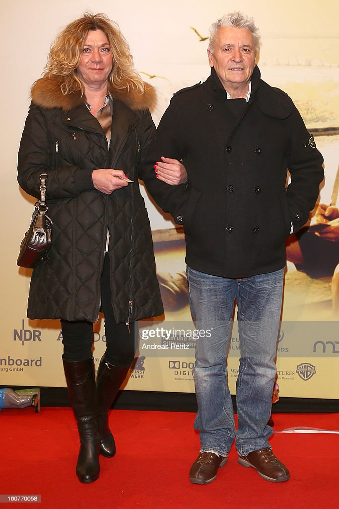 Henry Huebchen (R) and Carmen Kopplin attend 'Quelle des Lebens' Germany Premiere at Delphi Filmpalast on February 5, 2013 in Berlin, Germany.