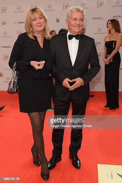 Henry Huebchen and Carmen Kopplin attend the Bambi Awards 2013 at Stage Theater on November 14 2013 in Berlin Germany