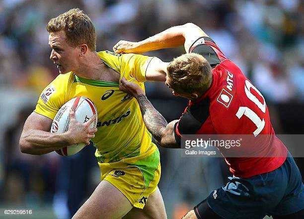 Henry Hutchison of Australia and A Kapalin of Russia during day 1 of the HSBC Cape Town Sevens Pool A Australia v Russia match at Cape Town Stadium...