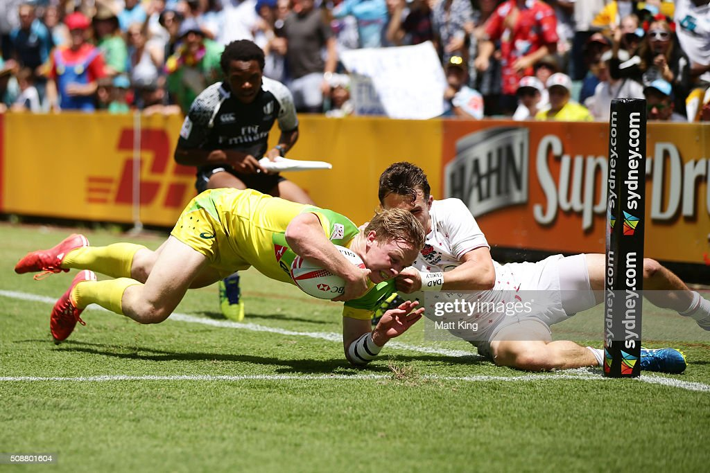 Henry Hutchison of Australia beats Alex Davis of England to score the winning try in golden point extra time during the 2016 Sydney Sevens Cup Quarter Final match between England and Australia at Allianz Stadium on February 7, 2016 in Sydney, Australia.