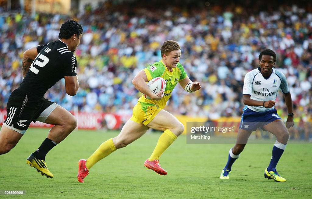 Henry Hutchison of Australia breaks the line to score a try during the 2016 Sydney Sevens Cup Final match between Australia and New Zealand at Allianz Stadium on February 7, 2016 in Sydney, Australia.