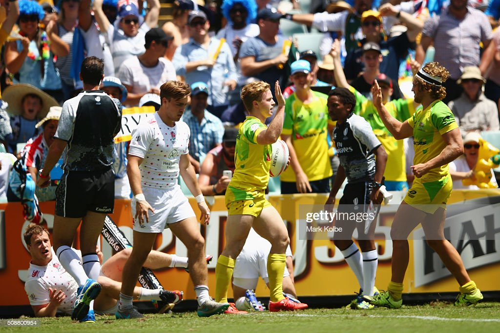 Henry Hutchison of Australia celebrates with his team mates after scoring a try during the 2016 Sydney Sevens cup quarter final match between Australia and England at Allianz Stadium on February 7, 2016 in Sydney, Australia.