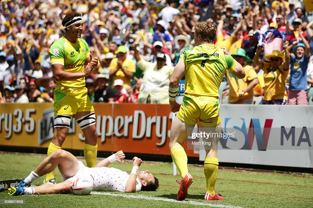 Henry Hutchison of Australia celebrates with Sam Myers of Australia after scoring the winning try in golden point extra time during the 2016 Sydney Sevens Cup Quarter Final match between England and Australia at Allianz Stadium on February 7, 2016 in Sydney, Australia.