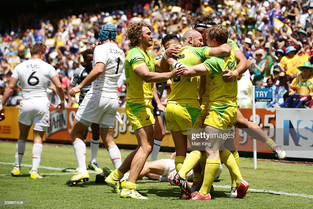 Henry Hutchison of Australia celebrates with team mates after scoring the winning try in golden point extra time during the 2016 Sydney Sevens Cup Quarter Final match between England and Australia at Allianz Stadium on February 7, 2016 in Sydney, Australia.