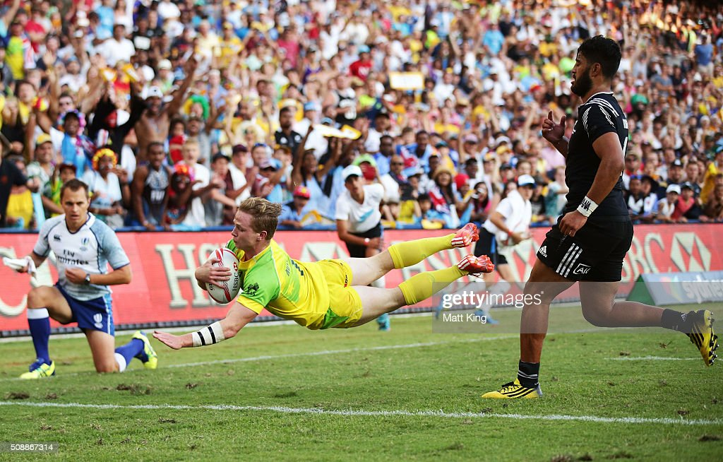 Henry Hutchison of Australia dives over in the corner to score a try during the 2016 Sydney Sevens Cup Final match between Australia and New Zealand at Allianz Stadium on February 7, 2016 in Sydney, Australia.