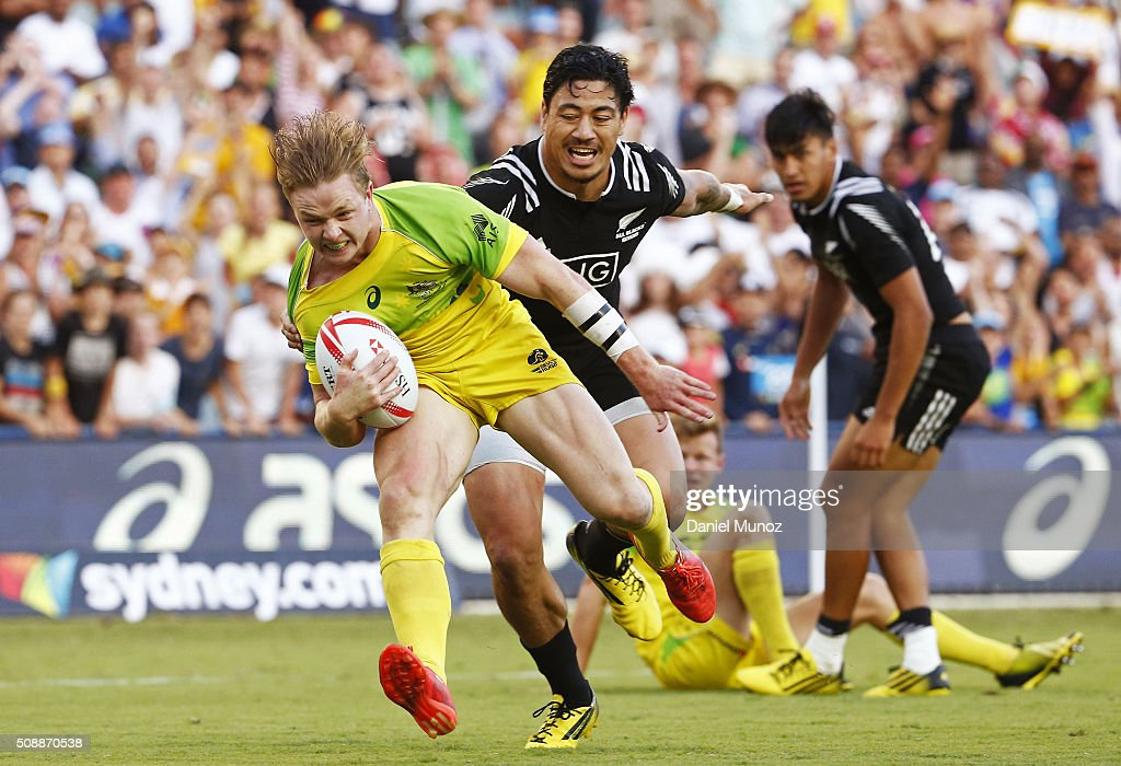 Henry Hutchison of Australia runs to score a try during the 20146 Sydney Sevens final match between Australia and New Zealand at Allianz Stadium on February 7, 2016 in Sydney, Australia.
