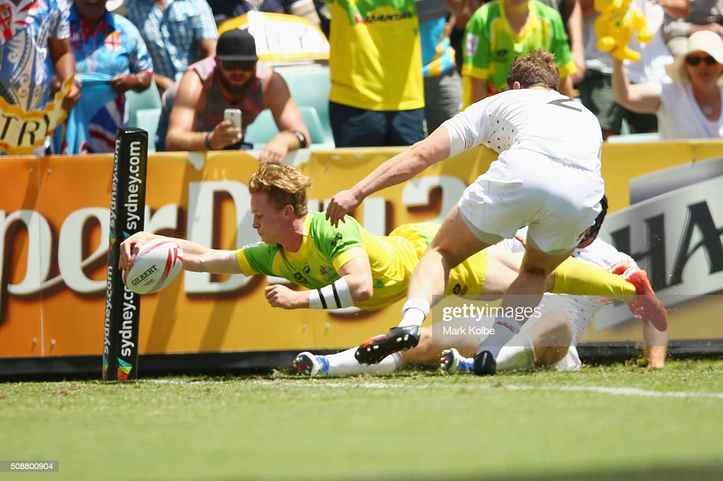 Henry Hutchison of Australia scores a try during the 2016 Sydney Sevens cup quarter final match between Australia and England at Allianz Stadium on February 7, 2016 in Sydney, Australia.