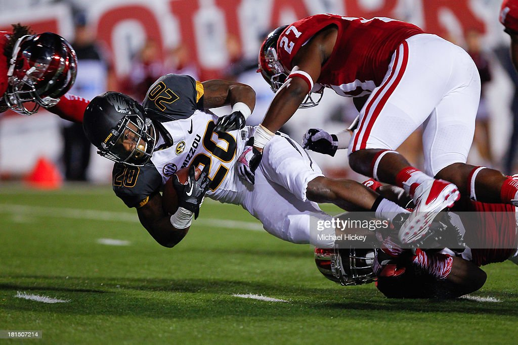 Henry Josey #20 of the Missouri Tigers falls to the ground after Steven Funderburk #27 of the Indiana Hoosiers tackles at Memorial Stadium on September 21, 2013 in Bloomington, Indiana.