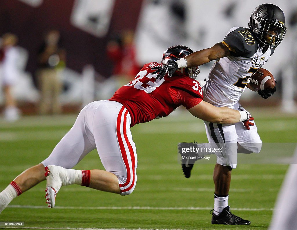 Henry Josey #20 of the Missouri Tigers runs the ball as Zack Shaw #33 of the Indiana Hoosiers tries to make the tackle at Memorial Stadium on September 21, 2013 in Bloomington, Indiana. Missour defeated Indiana 45-28.