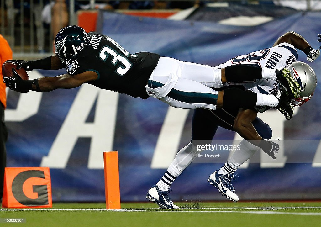 Henry Josey #34 of the Philadelphia Eagles scores as <a gi-track='captionPersonalityLinkClicked' href=/galleries/search?phrase=Duron+Harmon&family=editorial&specificpeople=8142142 ng-click='$event.stopPropagation()'>Duron Harmon</a> #30 of the New England Patriots defends during a pre-season at Gillette Stadium on August 15, 2014 in Foxboro, Massachusetts.