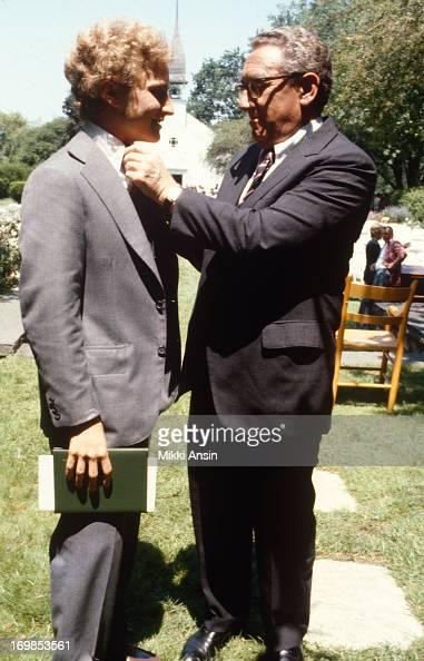 Henry Kissinger adjusts tie of son David Kissinger at his graduation ...