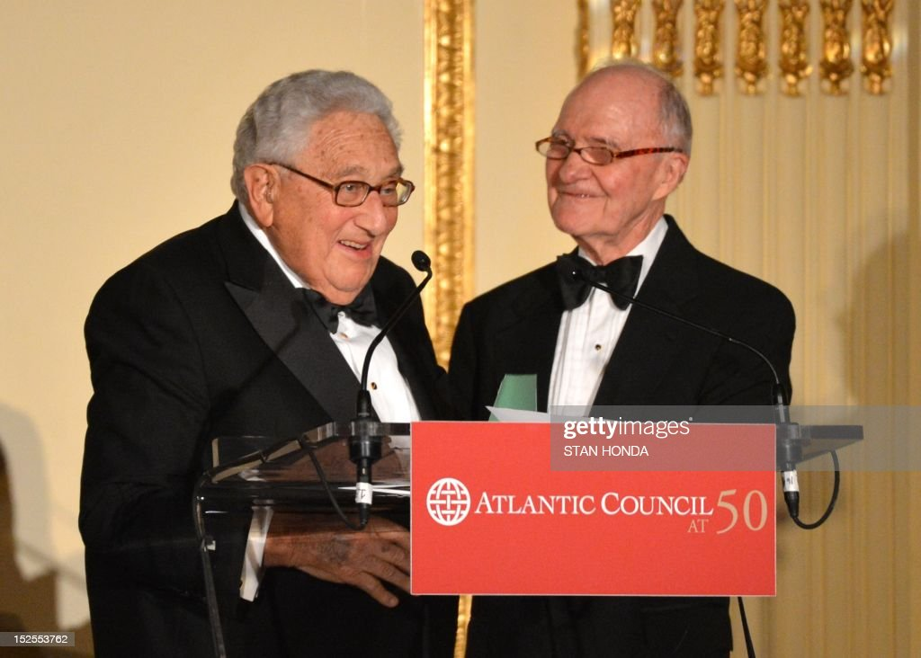 Henry Kissinger (L), former US Secretary of State and Nobel Peace Prize Laureate, receives the Atlantic Council's 2012 Global Citizen Award from General Brent Scowcroft (R), Chairman, Atlantic Council International Advisory Board September 21, 2012 in New York. AFP PHOTO/Stan HONDA