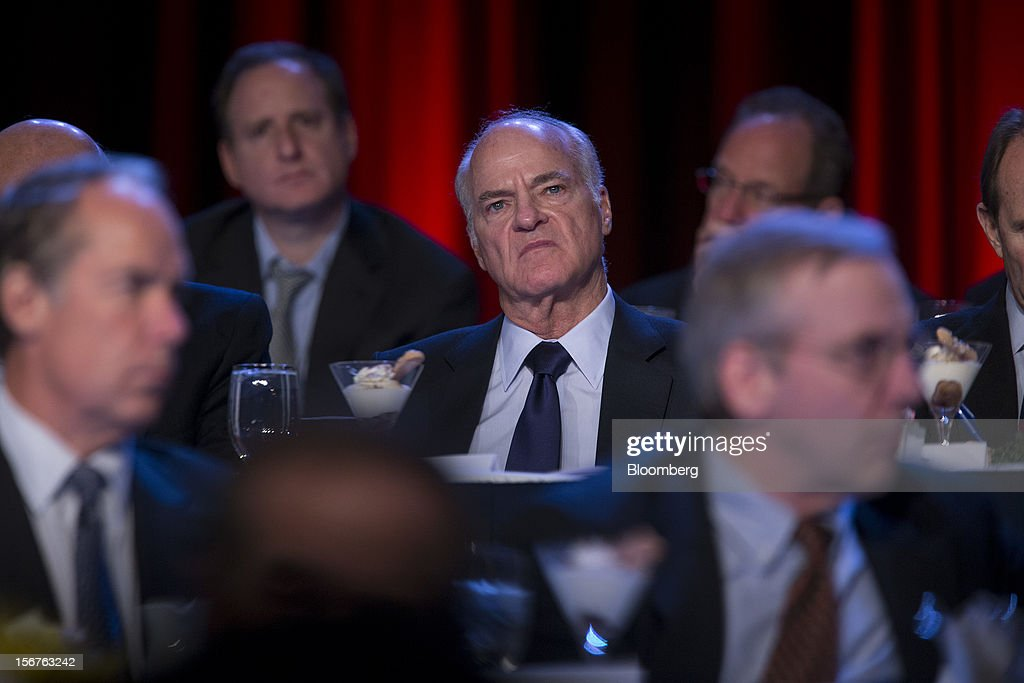 Henry Kravis, co-chairman, co-chief executive officer and co-founder of KKR & Co., listens as Ben S. Bernanke, chairman of the U.S. Federal Reserve, unseen, speaks to the Economic Club of New York in New York, U.S., on Tuesday, Nov. 20, 2012. Bernanke said that an agreement on ways to reduce long-term federal budget deficits could remove an impediment to growth, while failure to avoid the so-called fiscal cliff would pose a 'substantial threat' to the recovery. Photographer: Scott Eells/Bloomberg via Getty Images