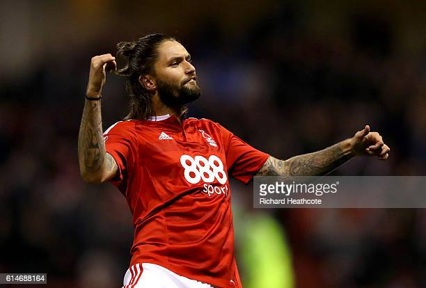 Henry Lansbury of Forest celebrates scoring only to have the goal disallowed by Referee Jeremy Simpson after speaking with his linesman during the...