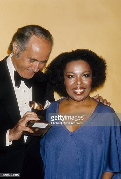 Henry Mancini and Roberta Flack pose backstage at the 18th Annual Grammy Awards on February 28 1976 at The Hollywood Palladium in Los Angeles...