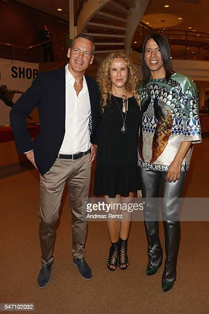 Henry Maske Katja Burkard and Jorge Gonzalez arrives for the Ballet Revolucion show premiere at the Philharmonie on July 13 2016 in Cologne Germany