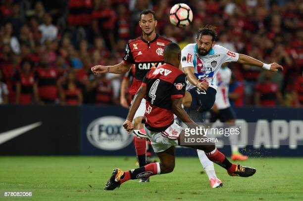Henry Mier of Colombia's Junior de Barranquilla fights for the ball with Juan of Brazil's Flamengo during their Copa Sudamericana 1st leg Semi Final...