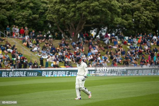 Henry Nicholls of New Zealand leaves the field after being dismissed during day three of the test match between New Zealand and South Africa at Basin...