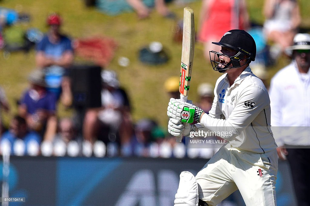 Henry Nicholls of New Zealand plays a shot during day three of the first cricket Test match between New Zealand and Australia at the Basin Reserve in Wellington on February 14, 2016. AFP PHOTO / MARTY MELVILLE / AFP / Marty Melville