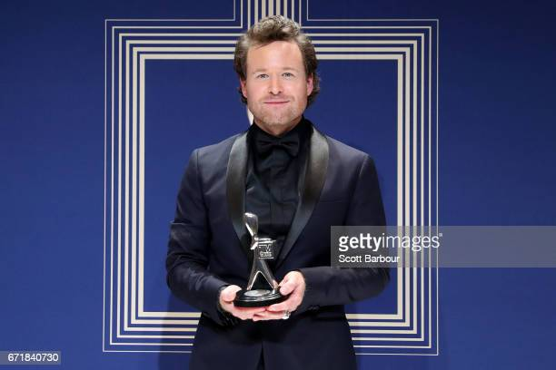 Henry Nixon poses with the Logie Award for Most Outstanding Actor 'The Kettering Incident' during the 59th Annual Logie Awards at Crown Palladium on...
