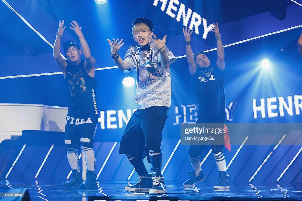 Henry (C) of boy band Super Junior M performs onstage during the Mnet 'M CountDown' at CJ E&M Center on June 20, 2013 in Seoul, South Korea.