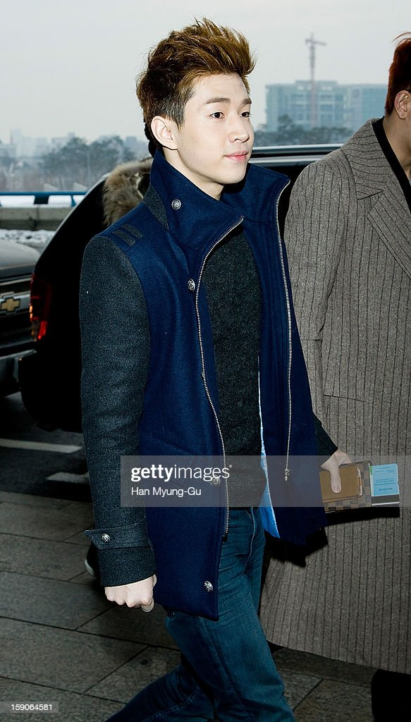 Henry of South Korean boy band Super Junior M is seen at Gimpo International Airport on January 7, 2013 in Seoul, South Korea.