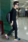 Henry of South Korean boy band Super Junior M is seen on departure at Gimpo International Airport on May 22 2014 in Seoul South Korea