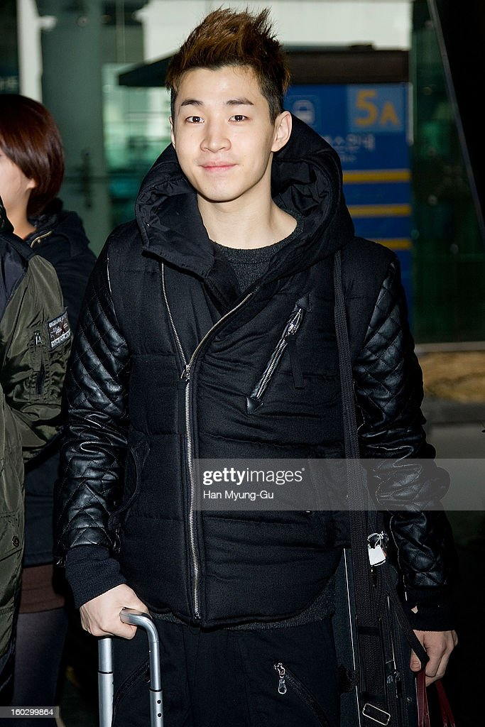 Henry of Super Junior M is seen at Incheon International Airport on January 28, 2013 in Incheon, South Korea.
