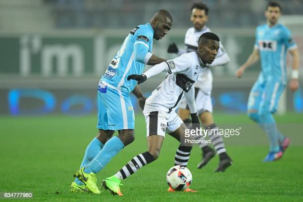 Henry Onyekuru Chukwuemeka forward of Eupen is challenged by Anderson Esiti midfielder of KAA Gent during the Jupiler Pro League match between KAA...
