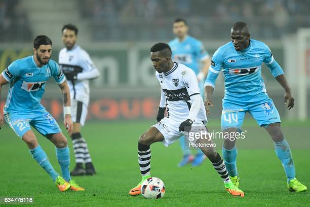 Henry Onyekuru Chukwuemeka forward of Eupen is challenged by Anderson Esiti midfielder of KAA Gent and Samuel Gigot defender of KAA Gent during the...