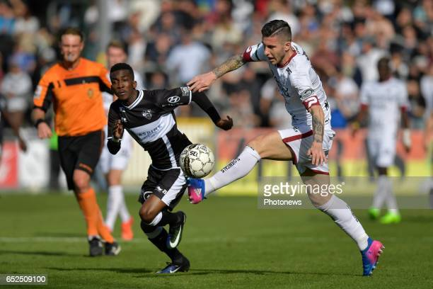 Henry Onyekuru of KAS Eupen and Luca Marrone of SV Zulte Waregem during the Jupiler Pro League match between KAS Eupen and SV Zulte Waregem at the...