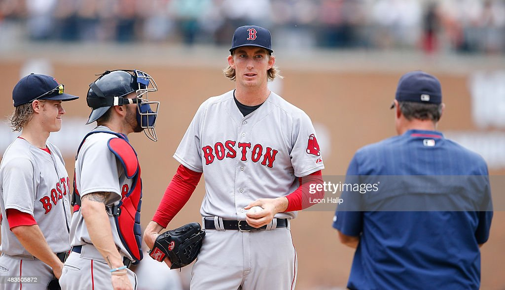 <a gi-track='captionPersonalityLinkClicked' href=/galleries/search?phrase=Henry+Owens&family=editorial&specificpeople=680587 ng-click='$event.stopPropagation()'>Henry Owens</a> #60 of the Boston Red Sox reacts as manager <a gi-track='captionPersonalityLinkClicked' href=/galleries/search?phrase=John+Farrell+-+Treinador+de+basebol&family=editorial&specificpeople=10307520 ng-click='$event.stopPropagation()'>John Farrell</a> #53 walks to the mound to make a pitching change during the sixth inning of the game against the Detroit Tigers on August 9, 2015 at Comerica Park in Detroit, Michigan.