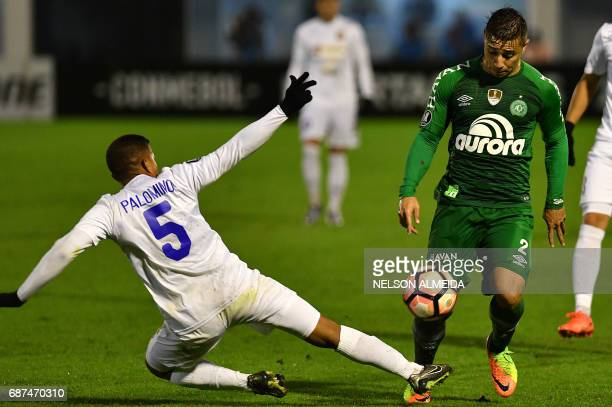 Henry Palomino of Venezuela's Zulia vies for the ball with Joao Pedro of Brazil's Chapecoense during their 2017 Copa Libertadores football match held...