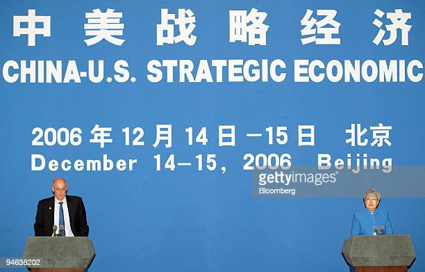 Henry Paulson US treasury secretary left and Wu Yi China's vice premier right take part in a joint briefing at the end of their Strategic Economic...