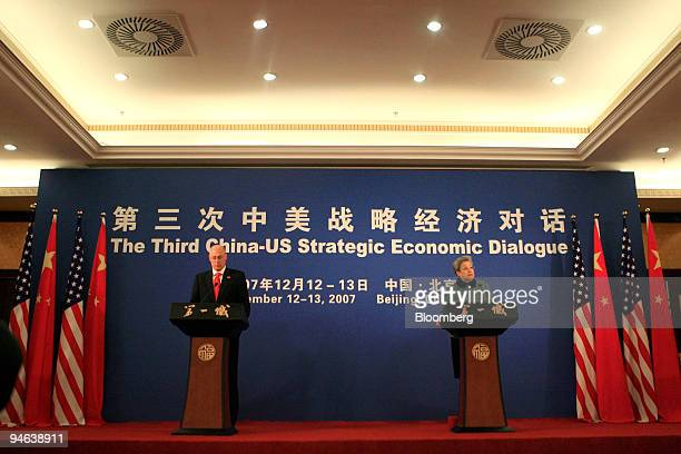 Henry Paulson US treasury secretary left and Wu Yi vicepremier of China attend the issuing of a joint statement by China and the United States at the...