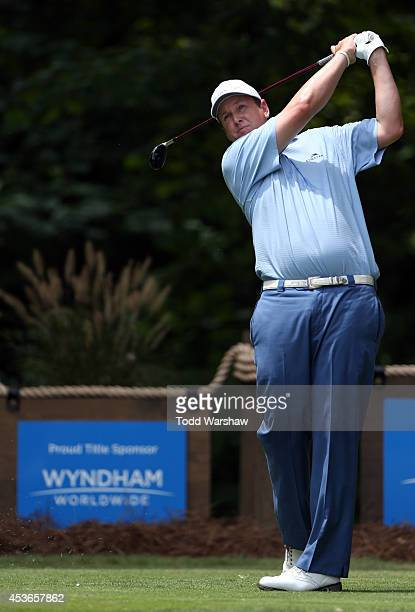 J Henry plays his tee shot on the second hole during the second round of the Wyndham Championship at Sedgefield Country Club on August 15 2014 in...