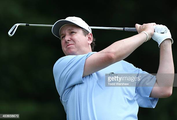 J Henry plays his tee shot on the seventh hole during the second round of the Wyndham Championship at Sedgefield Country Club on August 15 2014 in...