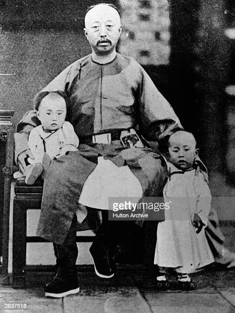 Henry PuYi last Emperor of China sitting on the lap of his father Prince Chun the Regent