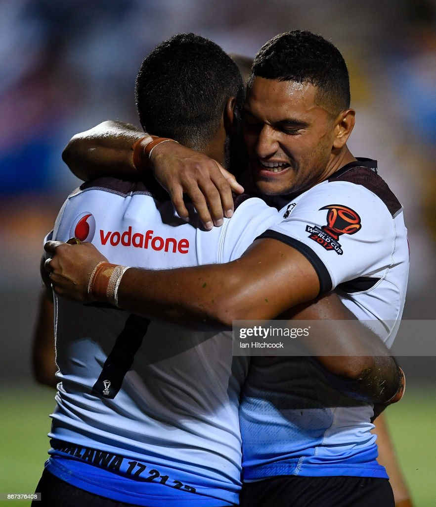 Henry Raiwalui (L) of Fiji celebrates after scoring a try with Marcelo Montoya of Fiji during the 2017 Rugby League World Cup match between Fiji and the United States on October 28, 2017 in Townsville, Australia.