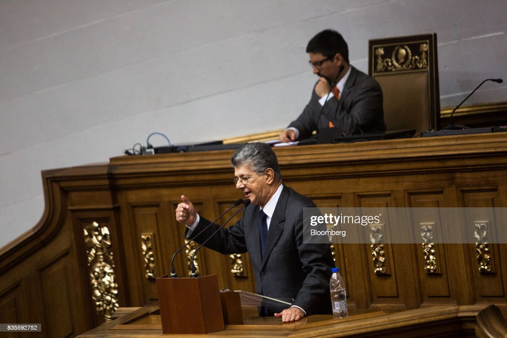 Henry Ramos Allup, former president of the National Assembly, center, speaks during a special session of the National Assembly of Caracas, Venezuela, on Saturday, Aug. 19, 2017. Venezuela's new legislative super body took over the functions of the country's only remaining opposition-run institution -- the National Assembly -- by approving a decree that empowers it to pass laws on a range of issues. Photographer: Wil Riera/Bloomberg via Getty Images
