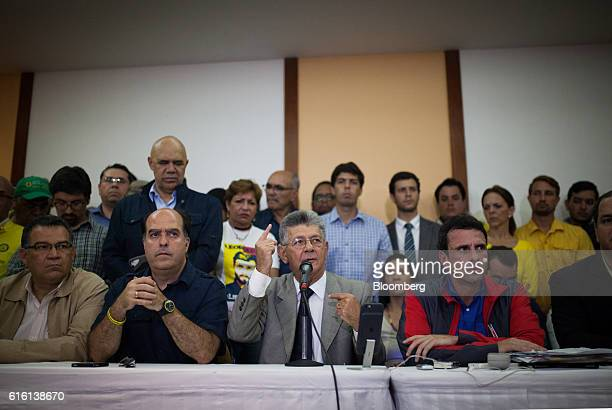 Henry Ramos Allup speaker of Venezuela's National Assembly center speaks as Henrique Capriles opposition leader and governor of the State of Miranda...