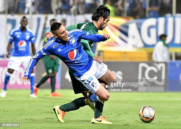 Henry Rojas of Millonarios struggles for the ball with Fabian Vargas of La Equidad during a match between Millonarios and La Equidad as part of round...