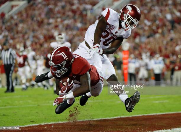 Henry Ruggs III of the Alabama Crimson Tide pulls in this touchdown reception against De'Andre Coley of the Arkansas Razorbacks at BryantDenny...