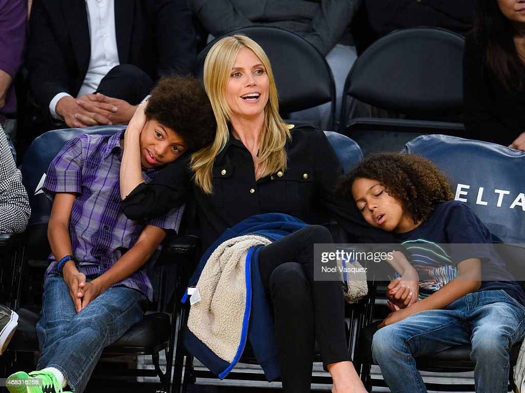 Henry Samuel Heidi Klum and Johan Samuel attend a basketball game between the New Orleans Pelicans and the Los Angeles Lakers at Staples Center on...