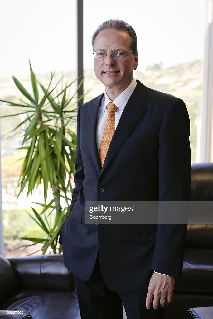 Henry Samueli, chairman, chief technology officer and co-founder of Broadcom Corp., stands for a photograph in his office at the company's headquarters in Irvine, California, U.S., on Friday, April 12, 2013. Broadcom Corp. designs, develops, and supplies integrated circuits for cable set-top boxes, cable modems, high-speed networking, direct satellite and digital broadcast, and digital subscriber line. Photographer: Patrick Fallon/Bloomberg via Getty Images