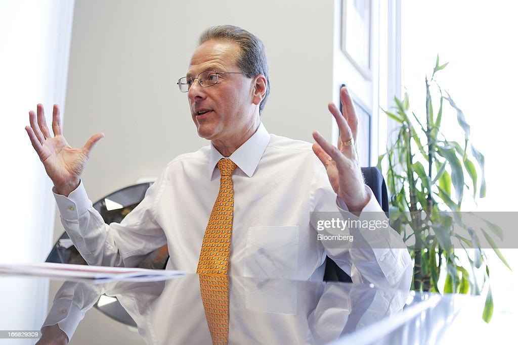 Henry Samueli, chairman, chief technology officer and co-founder of Broadcom Corp., speaks during an interview in his office at the company's headquarters in Irvine, California, U.S., on Friday, April 12, 2013. Broadcom Corp. designs, develops, and supplies integrated circuits for cable set-top boxes, cable modems, high-speed networking, direct satellite and digital broadcast, and digital subscriber line. Photographer: Patrick Fallon/Bloomberg via Getty Images